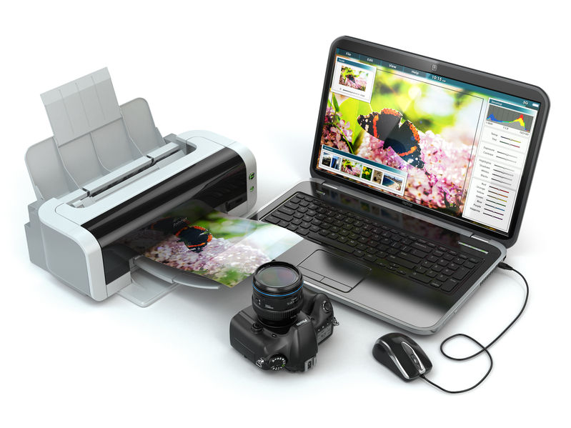 Laptop, photo camera and printer